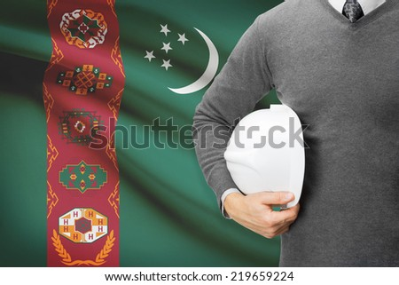 Engineer with flag on background  - Turkmenistan - stock photo