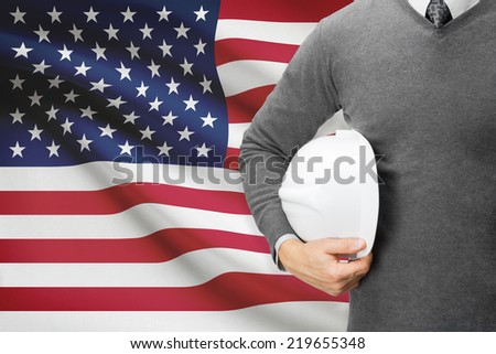 Engineer with flag on background  - United States of America - stock photo