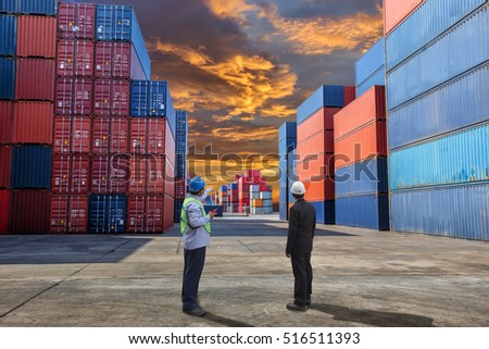 Engineer with his manager check for shipping the container box loading at yard.