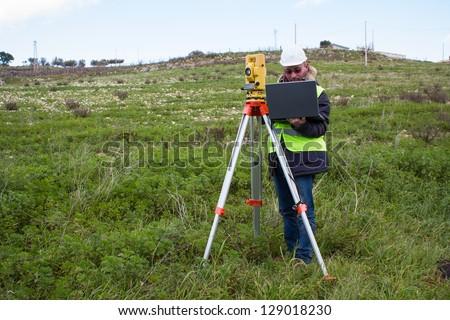 engineer with theodolite - stock photo