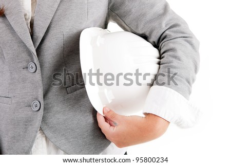 Engineer woman holding a white yellow helmet - stock photo