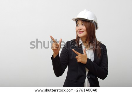 Engineer woman looking space on Right side - stock photo