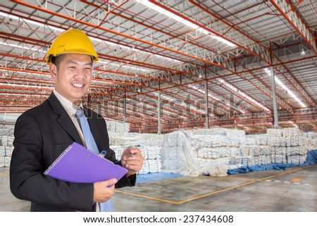 Engineer working in the warehouse surgar bag - stock photo