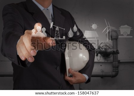 engineer working new computer with the piping of an industrial waste water cleaning facility as concept