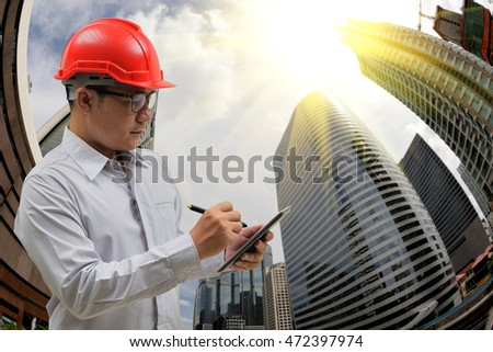 engineer working on city views background,shot with a Fisheye lens.