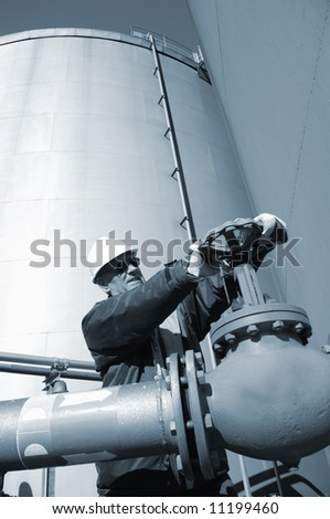 engineer working on pipeline pump, blue toning concept - stock photo