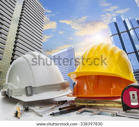 engineer working table against sky scrapper in urban scene use for land development and architecture occupation theme - stock photo
