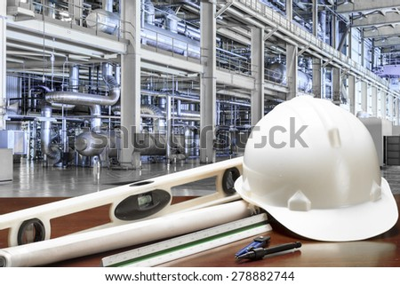 Engineer working table plan at equipments and machinery in a modern thermal power plant - stock photo