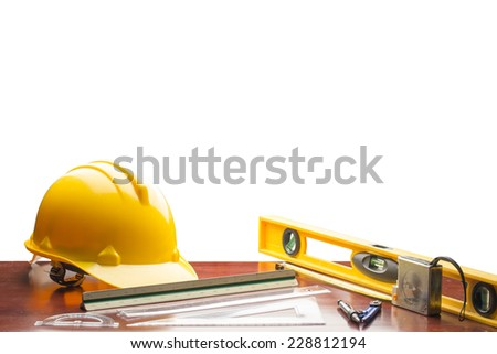 engineer working table plan building model and writing tool equipment isolated on white background with clipping path - stock photo