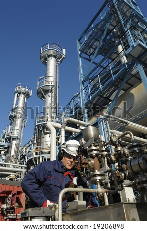 engineer, working with pipeline controls inside oil and gas refinery - stock photo