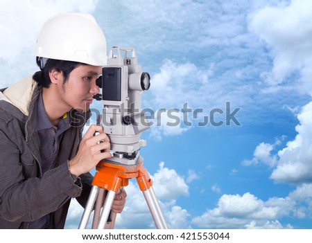 engineer working with survey equipment theodolite with blue sky background