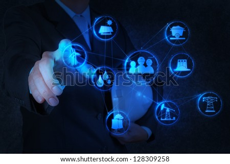 engineer works industry diagram on virtual computer - stock photo