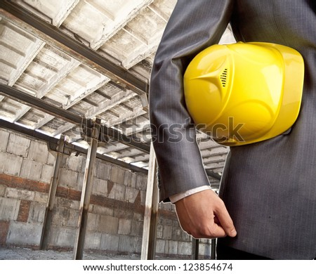 engineer yellow helmet for workers security in the interior of w - stock photo