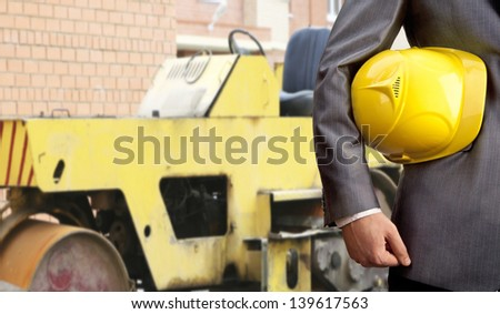 engineer yellow helmet for workers security over yellow rink road construction
