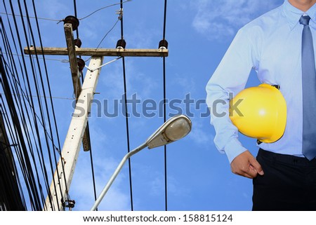 Engineering and electricity post in blue sky  - stock photo