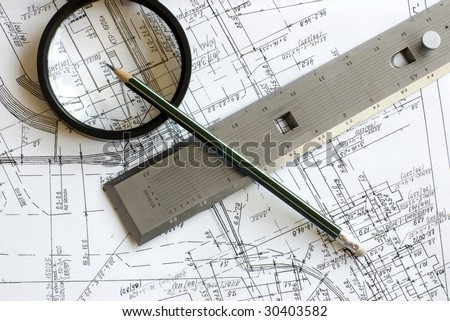 Engineering blueprint with pencil, loupe and steel scale ruler