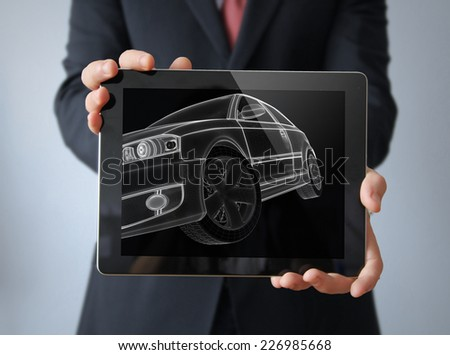 engineering car concept: lines car render on a businessman tablet - stock photo