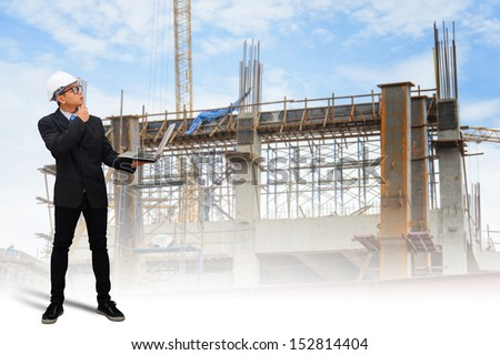 Engineering checking work plant on laptop  - stock photo