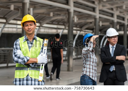 engineering construction concept : professional engineer team meeting foreman group plan manufacturing industry , selective focus