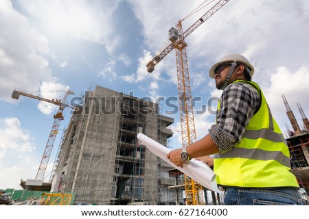 Engineering consulting people on construction site stock photo edit engineering consulting people on construction site holding blueprint in his hand building inspector construction malvernweather Gallery