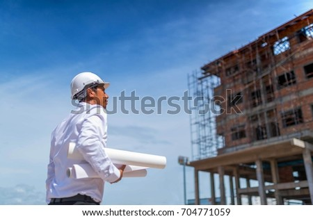Engineering consulting people on construction site stock photo engineering consulting people on construction site holding blueprint in his hand building inspectornstruction malvernweather Gallery