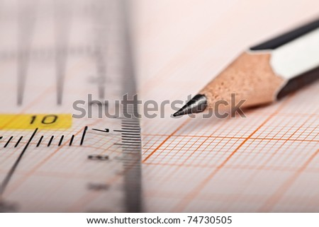 Engineering drawing equipment, Millimeter paper, ruler and pencil - stock photo