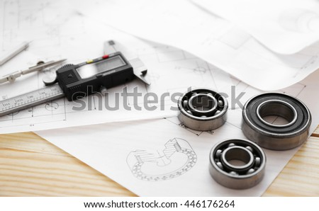 Engineering drawings of parts with tools closeup
