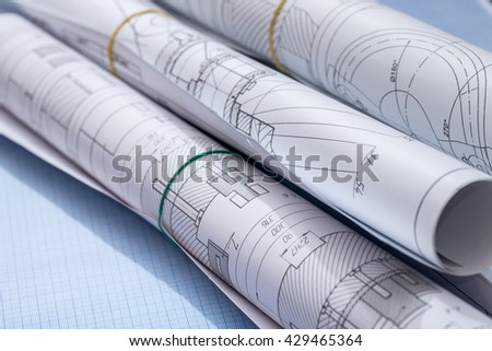engineering drawings on graph paper - stock photo
