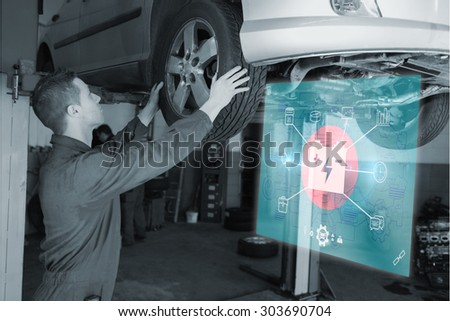 Engineering interface against auto mechanic examining car tire