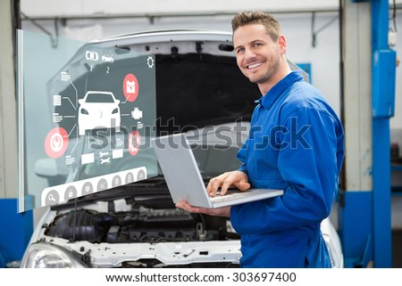 Engineering interface against mechanic typing on a laptop - stock photo