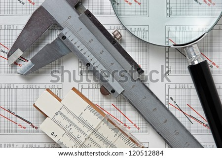 engineering tools on a technical drawing