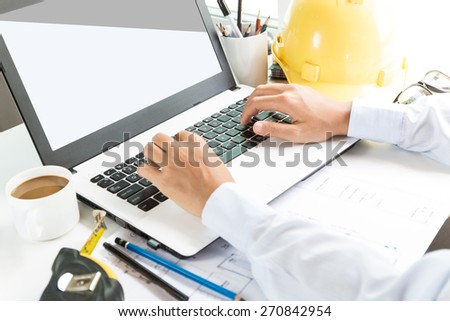 engineering use laptop computer on workspace - stock photo