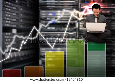 Engineering with graph in server room - stock photo