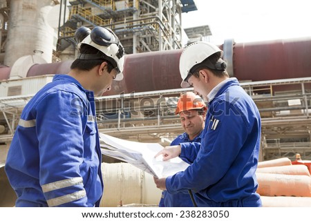Engineers and foremen in the factory. - stock photo