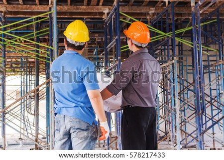 Engineers meetings conversations blueprint construction work stock engineers and meetings conversations with a blueprint for the construction work malvernweather Image collections