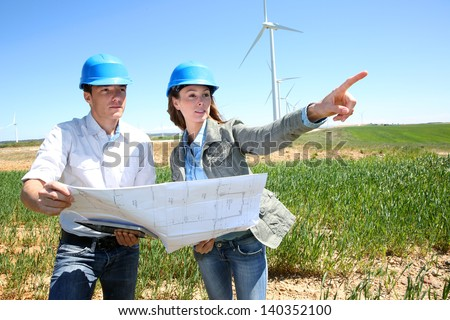 Engineers checking on industrial site - stock photo