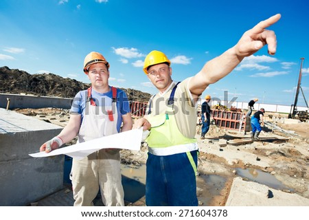engineers construction foreman managers outdoors indoors at building site with blueprints - stock photo