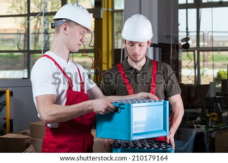 Engineers during working in a factory, horizontal - stock photo