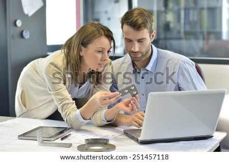 Engineers in industrial sector working in office - stock photo