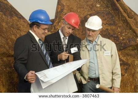 Engineers studying plans - stock photo