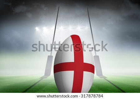 England flag rugby ball against rugby pitch - stock photo