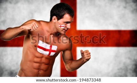 England football fan is ready for fight over england flag background - stock photo