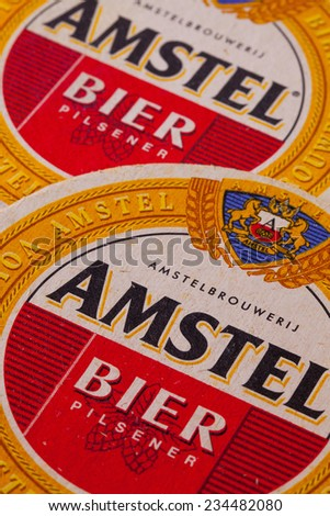 ENGLAND,LONDON - November 11, 2014:Beermats from Amstel beer.Amstel Brewery is a Dutch brewery founded in 1870 on the Mauritskade in Amsterdam - stock photo