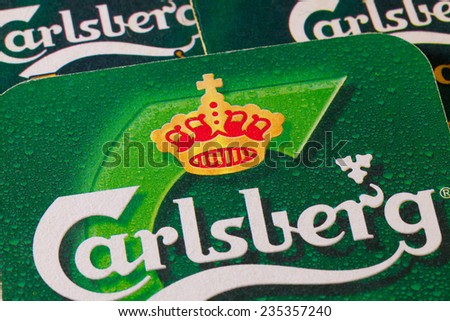 ENGLAND,LONDON - November 11, 2014:Beermats from Carlsberg beer.The Carlsberg is a Danish brewing company founded in 1847 by J. C. Jacobsen with headquarters located in Copenhagen,Denmark - stock photo