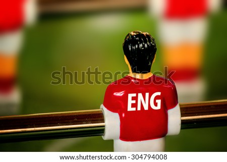 England National Jersey on Vintage Foosball, Table Soccer or Football Kicker Game, Selective Focus, Retro Tone Effect - stock photo