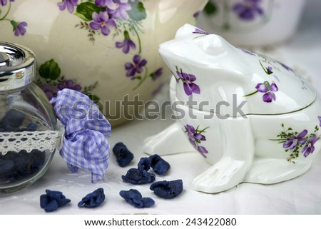 English afternoon tea with sweet and candied violets - stock photo