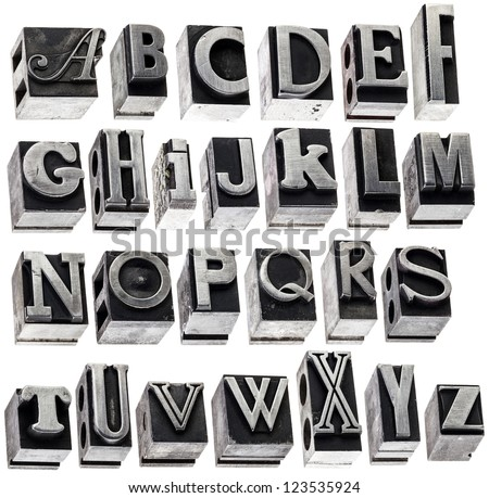 English alphabet - a collage of 26 isolated letters in grunge letterpress metal type block, a variety of fonts - stock photo