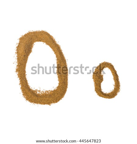 "English alphabet. Letter ""O"" made of sand isolated on white background."