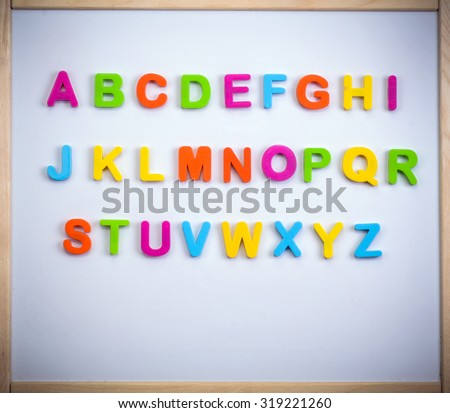 English alphabet made of plastic letters on a magnetic board