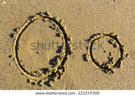 English alphabet written in sand. letter O - stock photo